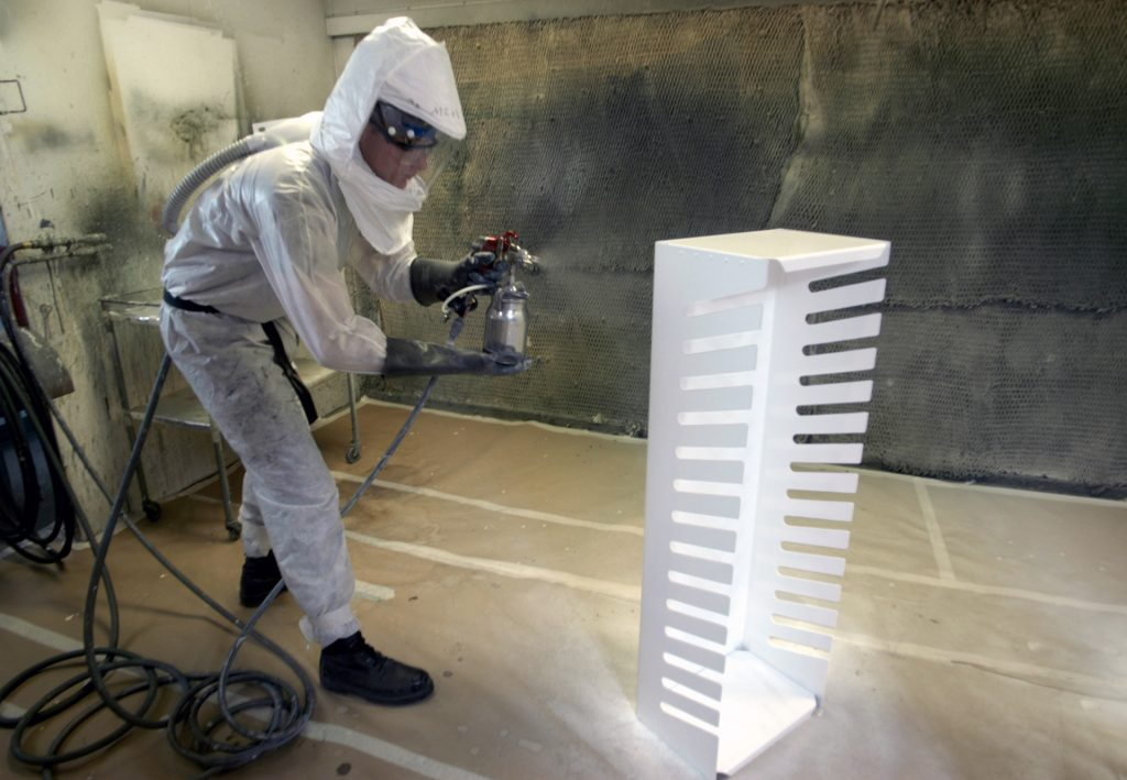 man spray painting depicting an example of Occupational Asthma