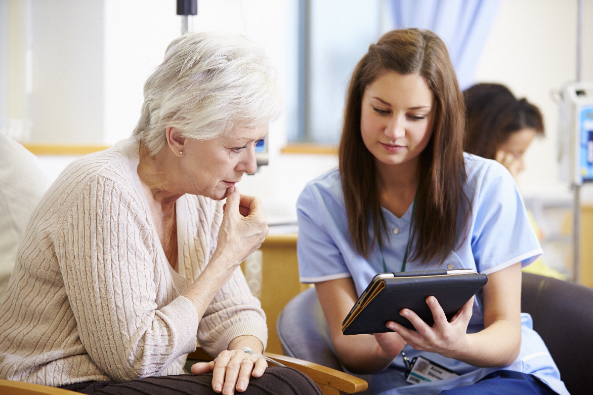 two women learning about Asthma Education