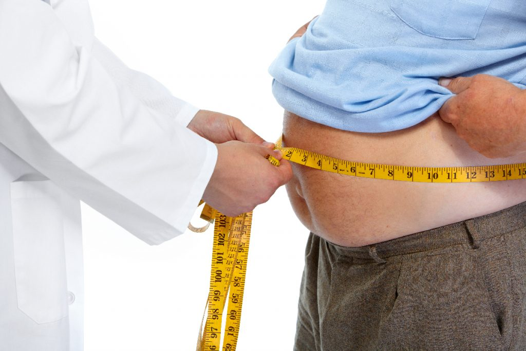 image of a man being measured for asthma and Obesity