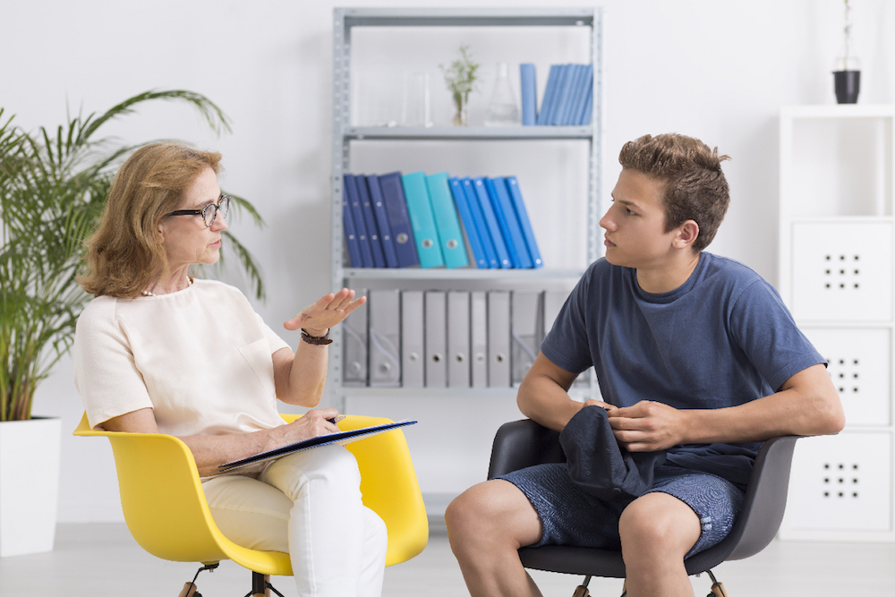 woman and and a young adult discussing asthma and adolesence